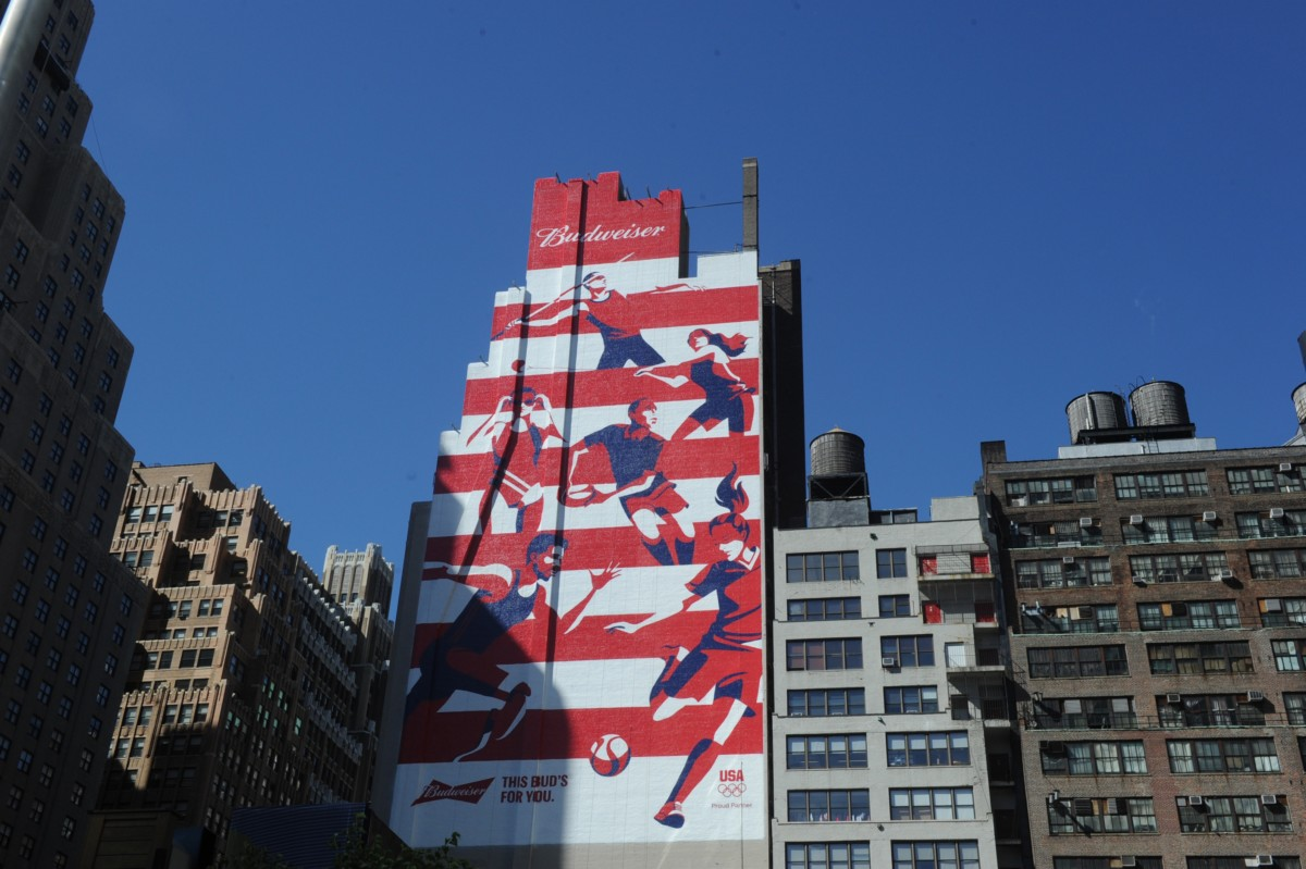Budweiser unveils a 225-ft mural erected in honor of Team Budweiser, the six Olympic and Paralympic hopefuls that the brand is supporting on their journey to Rio, Thursday, June 9, 2016 in New York. (Diane Bondareff/AP Images for Budweiser)